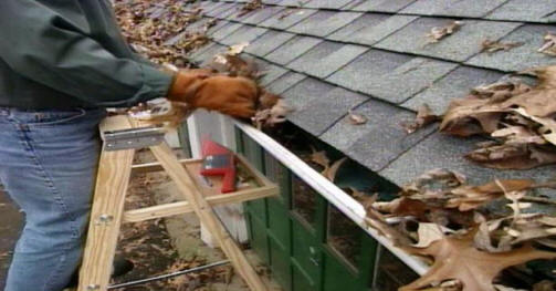 cleaning gutters 53